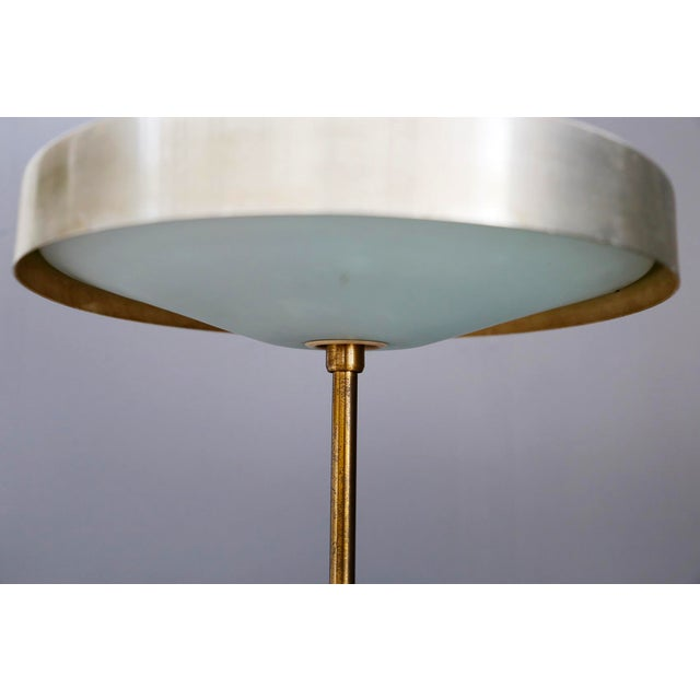 Rare table lamp created by Oscar Torlasco for LUMI in 1950. The lamp was published in Domus, a furniture magazine. Its...