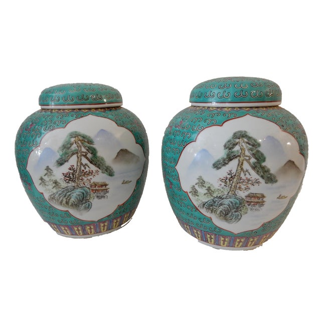 A superb pair of turquoise ginger jars with lids. The background of each is painted in amazing turquoise with blossom...