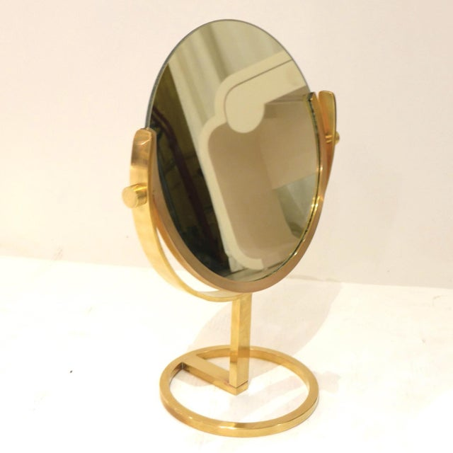 A heavy high quality brass vanity or table mirror with beautiful patina and sleek proportions that would look great on any...