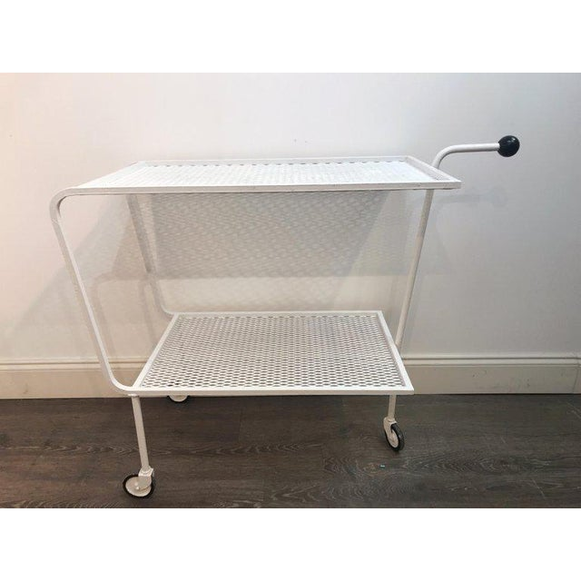 Modern wrought iron bar cart in the attributed to Salterini, of modern form with single handle with ball handle, moves...