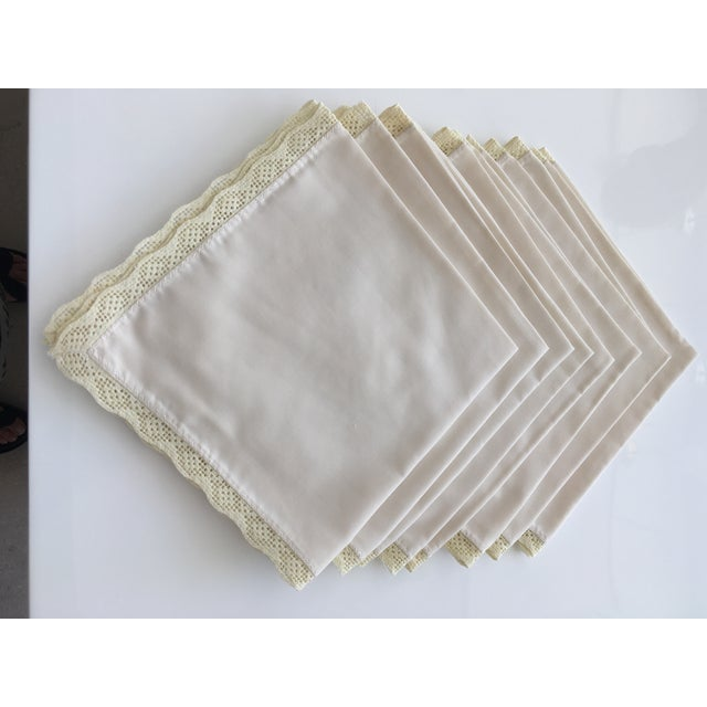 Set of eight ecru color square table napkins with embroidered edge. I am not sure if the embroidery is hand stitched or...