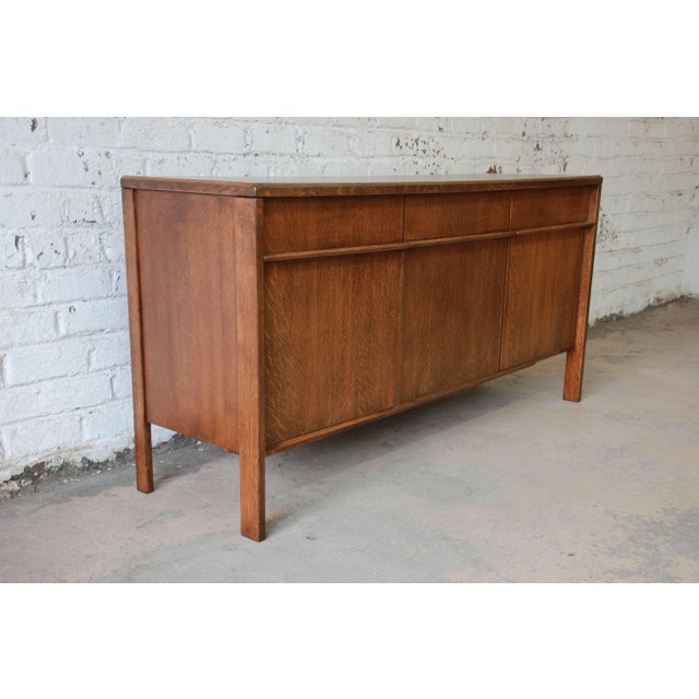 Offering a rare beautifully restored Scandinavian Modern quarter sawn oak sideboard credenza by Cees Braakman for Pastoe....