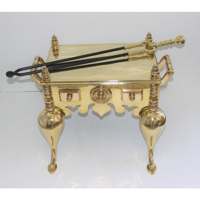 This tea kettle warmer is intended to be placed in the hearth, with the kettle placed on the top, and then smoldering...