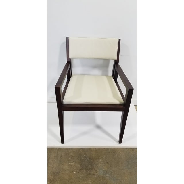 Beautiful wood guest chair has a unique details. The arms connect to the seat leaving space between the back rest. The...
