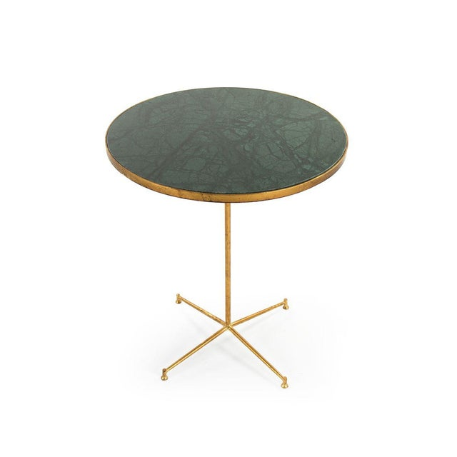 Round end table with deep green marble top and gold leaf finished base.