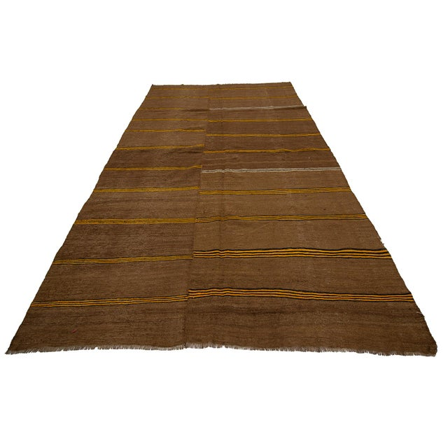 Brown handwoven vintage kilim rug from Kars region of Turkey. Approximately 50-60 years old. In very good condition