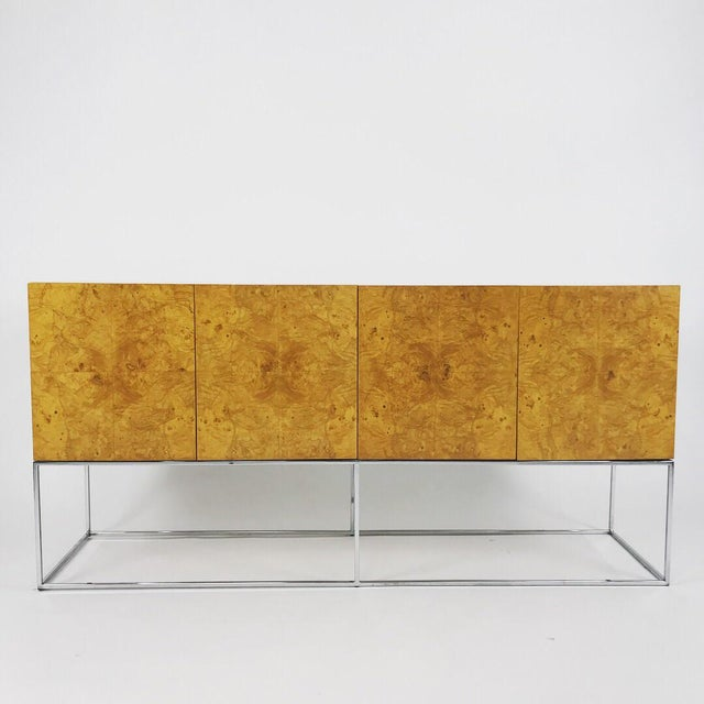 This is a wonderful example of a olive burl credenza with a chrome base that was designed by Milo Baughman for Thayer...