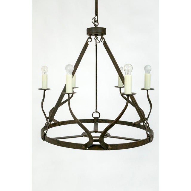 This rustic, iron, 6-light chandelier has a presence both dominant and elegant. A beautifully proportioned piece, with a...