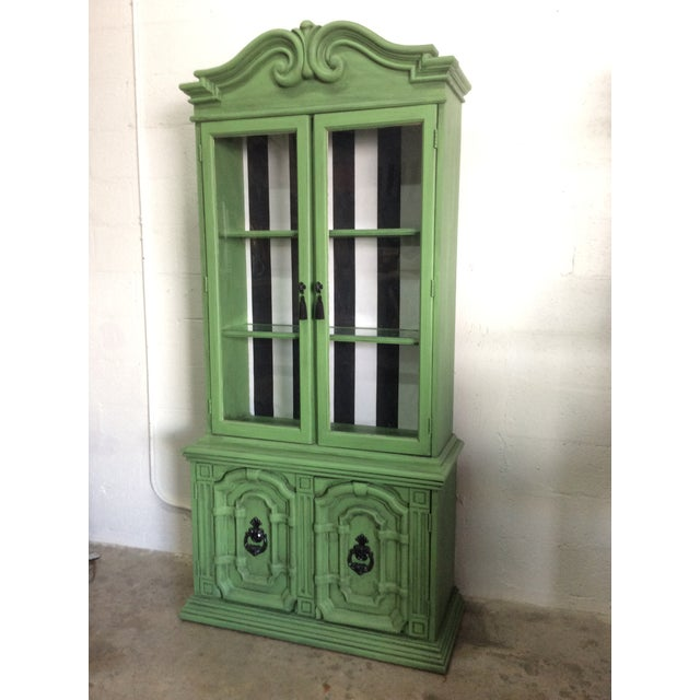 Hand painted regency, quirky chinoiserie emerald green hutch with black and white striped fabric insert. This is certainly...