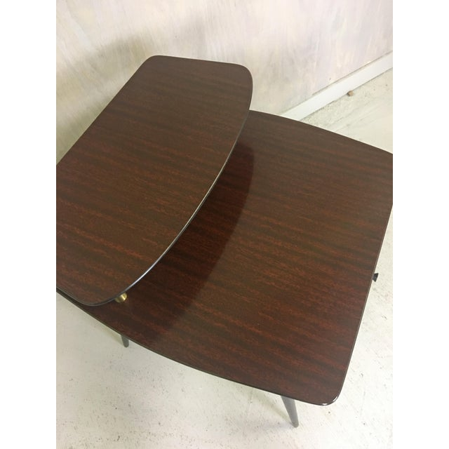 "This ""jetsonesque"" tiered ""mahogany look"" laminate side table features splayed tapered legs and a small drawer. Great..."
