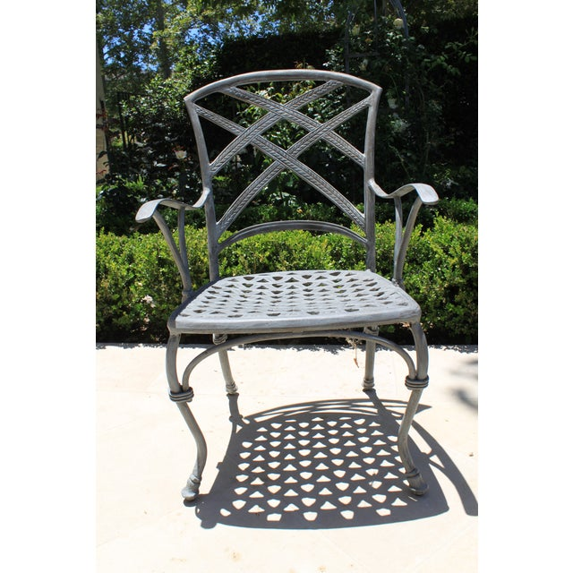 Custom French iron handcrafted garden set seating 4 people. Made in the early 21st century.