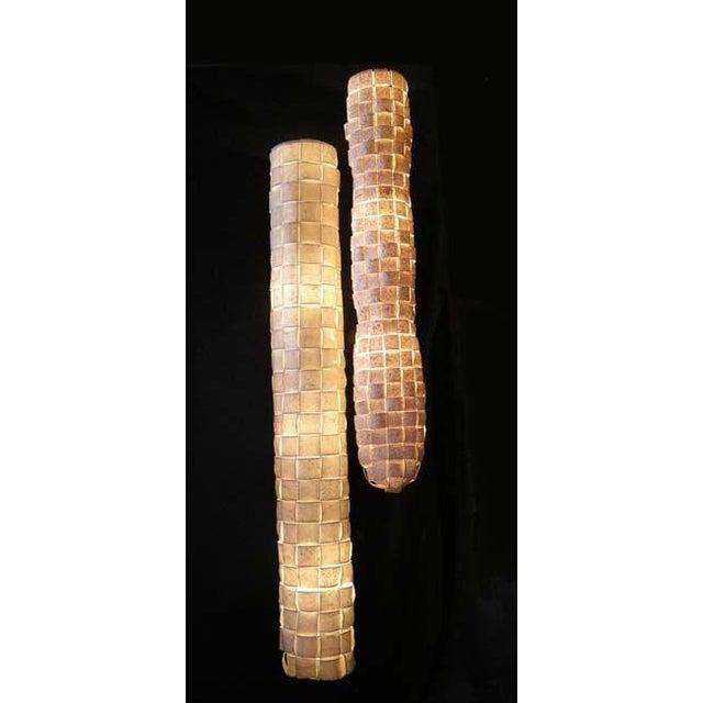 """Izanagi"" and ""Izanami"" long tube hanging lights made by Japanese lighting designer Yuri Kinoshita. Woven hand made paper...."