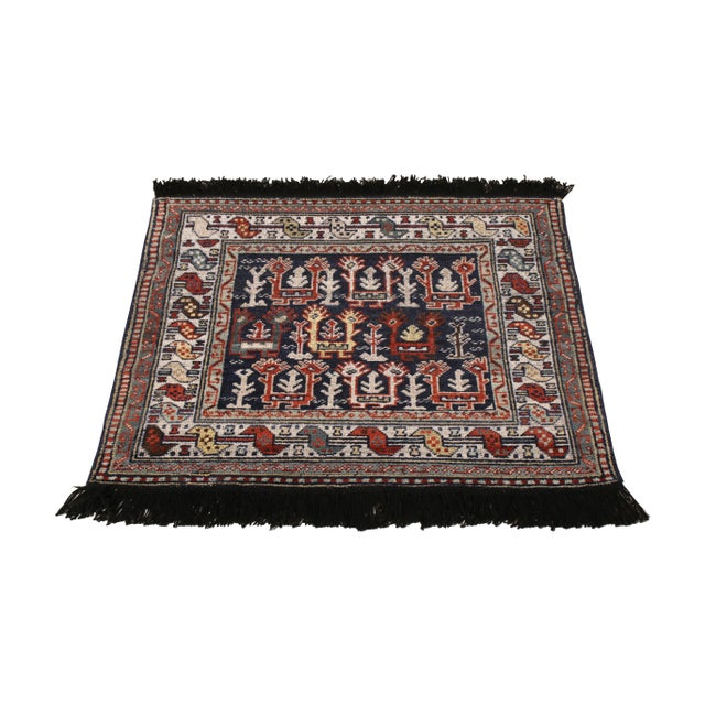 A 3x3 ode to classic tribal rugs in red and blue, from Rug & Kilim's Burano Collection. Hand knotted in notably soft...