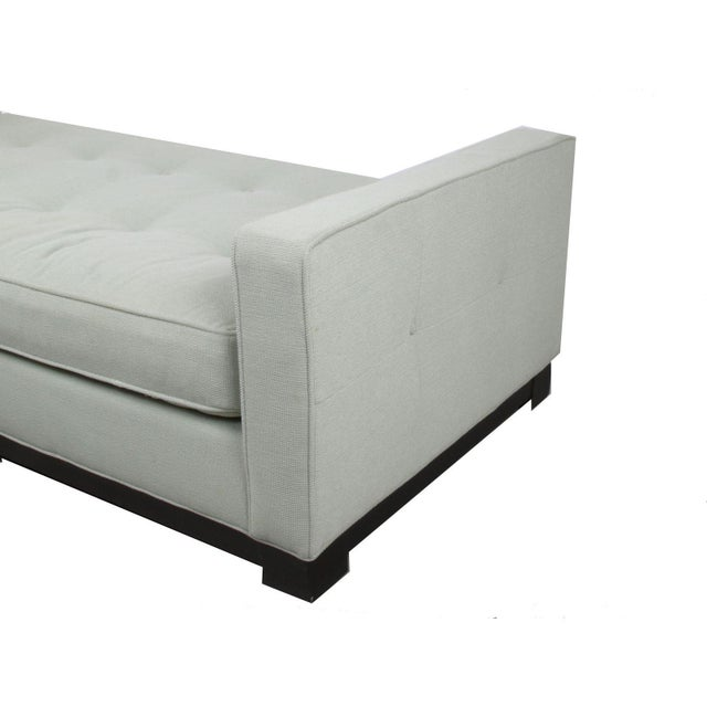 Transitional Modernist Style daybed, button tufted with selfwelt detail. Base is a brown mahogany on oak finish with...