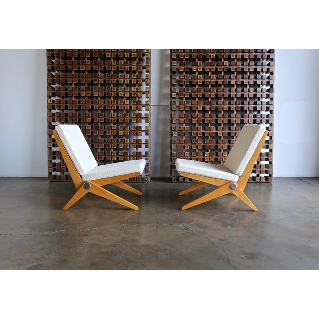 Pair of Scissor lounge chairs by Pierre Jeanneret for Knoll International, circa 1955. This pair has been professionally...