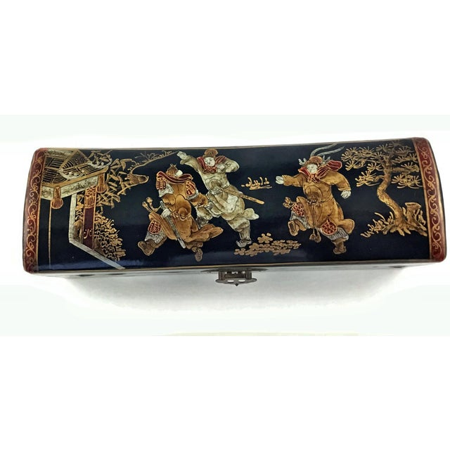 An exquisite Chinese leather money pillow with gilt gold hand painted warriors. The top is slightly padded for comfort and...