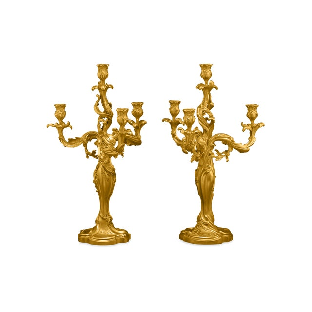 An exceptional pair of hand-chased doré bronze candelabra by the distinguished French sculptor Eugène Lelièvre, and...