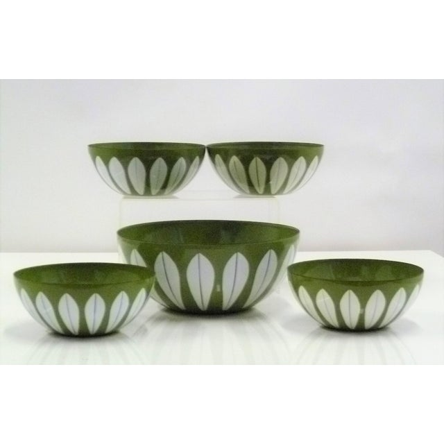 Mid-century Scandinavian Modern enameled olive green Lotus Bowls designed by Grete Prytz Kittelsen. Set consisting of one...