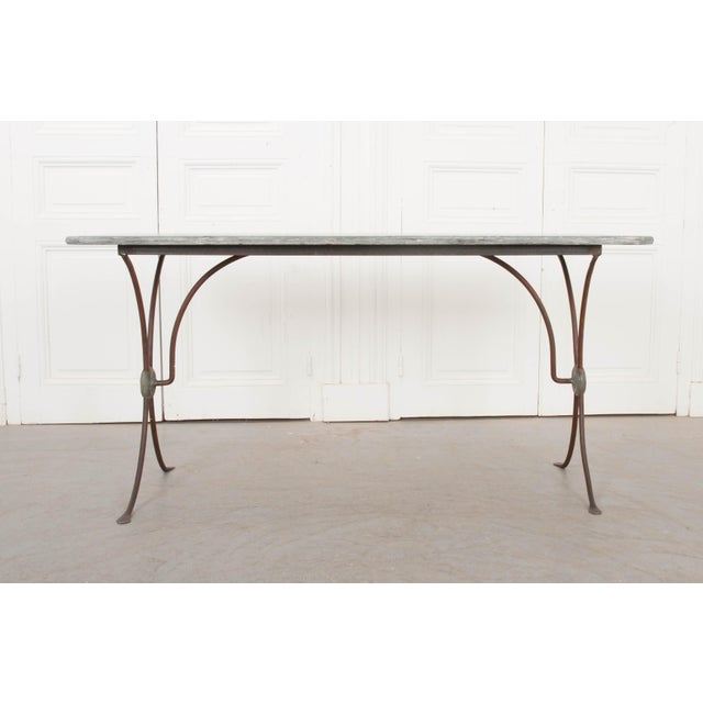 This elegant Art Nouveau marble-top and iron bistro table, c. 1890 is from France and features a black marble top with...
