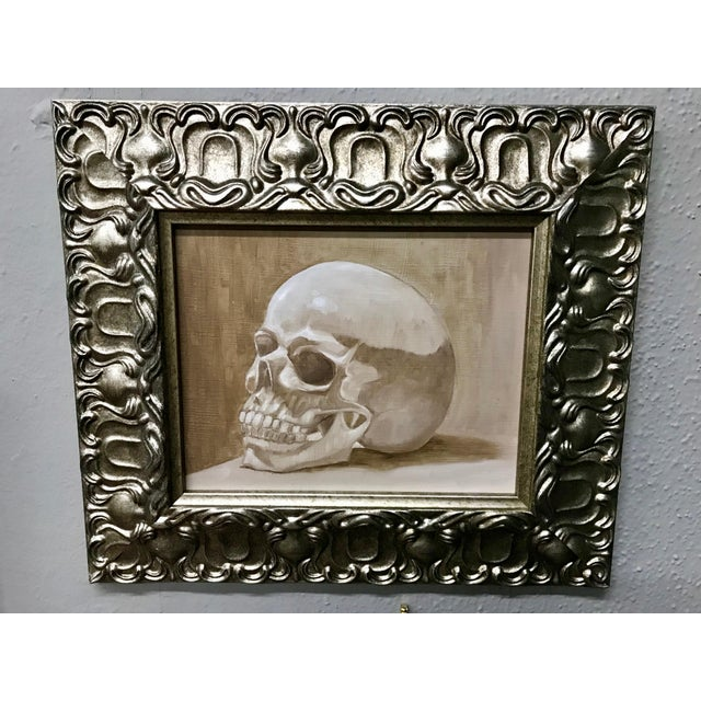 This piece is so cool! The juxtaposition of the skull framed in a fancy baroque pewter frame is just perfection. The...
