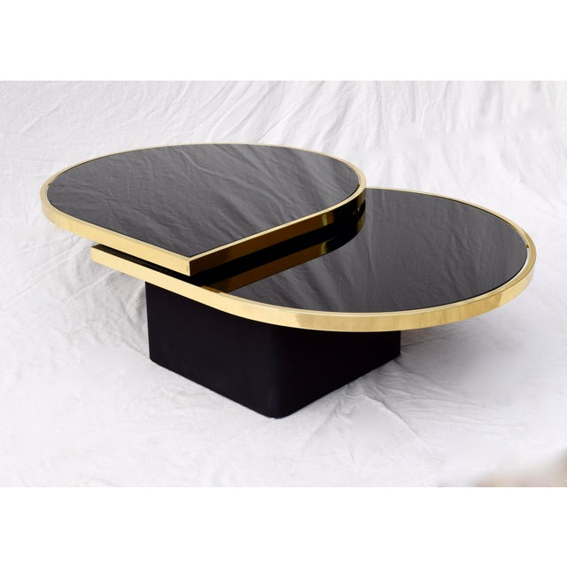 Swivel Brass & Black Glass Cocktail Table by Design Institute of America For Sale In Philadelphia - Image 6 of 13