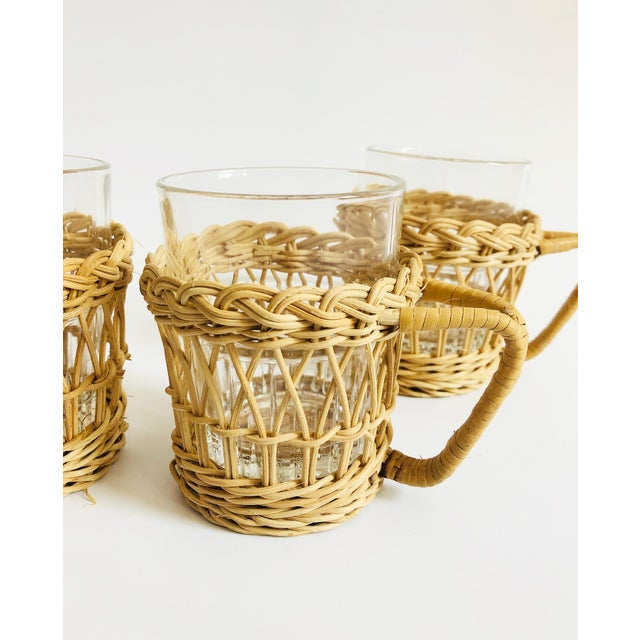 A great set of 4 vintage boho glasses with wicker holders. Each holder has a lovely woven pattern and sturdy handle. The...