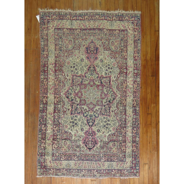 A 19th century shabby chic one of a kind hand-made lavar kerman rug.