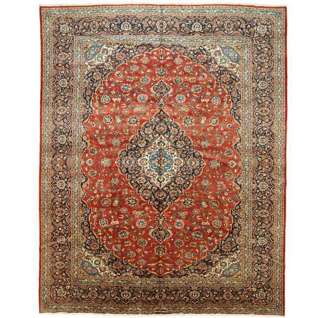 Antique Kashan circa 1950 rug in a traditional style. There is nothing like adding a classic rug to be the staple of a...
