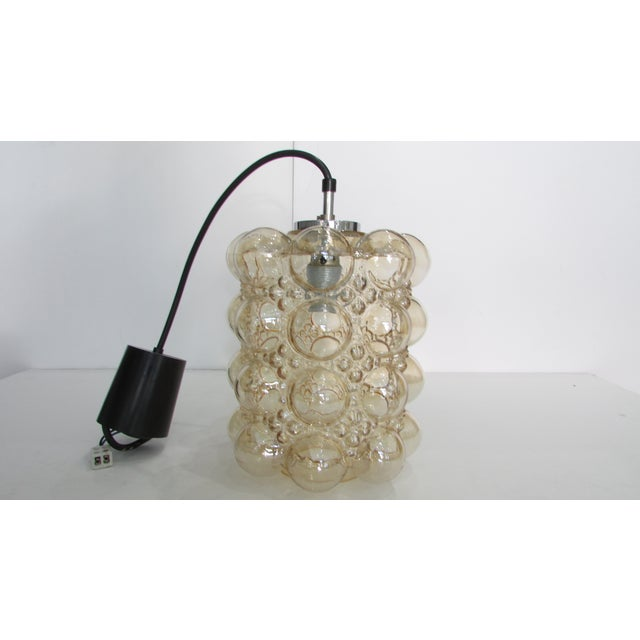 Mid-Century iconic pendant light most likely by designer Helen Tynell. The bubble glass has a pale amber hue and looks...