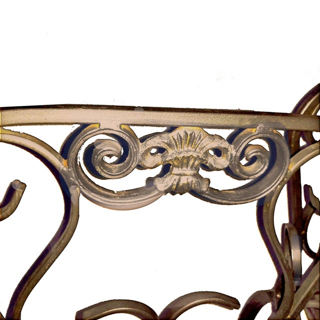 Italian wrought iron bar stool that feature scrolling square shaped rod seat back that features a gold toned cast crest...