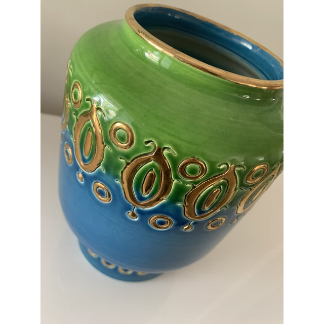 Elegant, colorful vase. Featuring gorgeous blue fading into green with repeating gold shapes. By Aldo Londi, artistic...