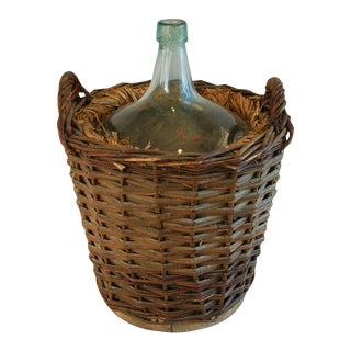 Early 1900s French Demijohn Bottle With Grape Vine Basket For Sale