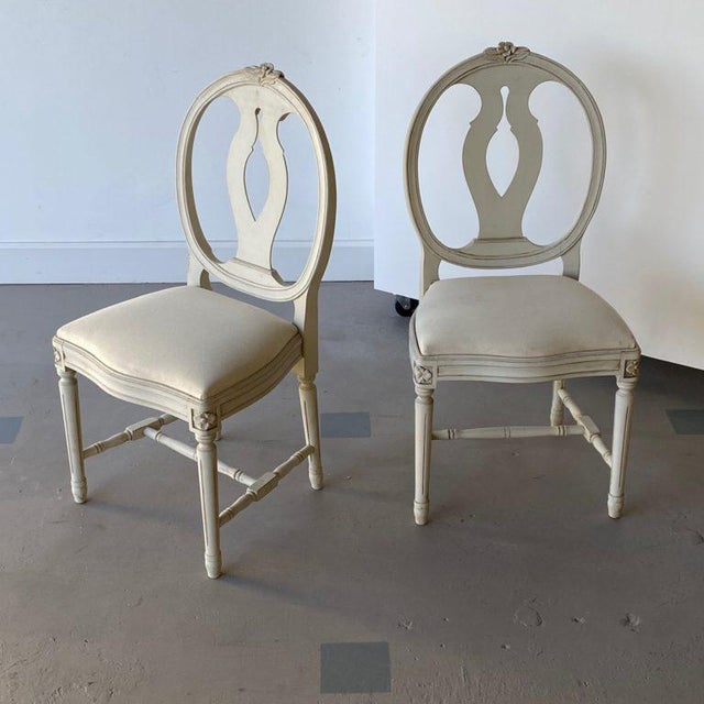 Pair of mid-20th-c. carved Swedish Gustavian-style side chairs. Newly added muslin base, ready for new upholstery. Height:...
