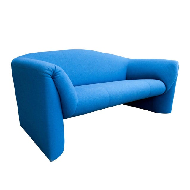 """Custom made modern blue loveseat produced by the long-standing Dutch manufacturer, Leolux. From the Leolux website: """"The..."""