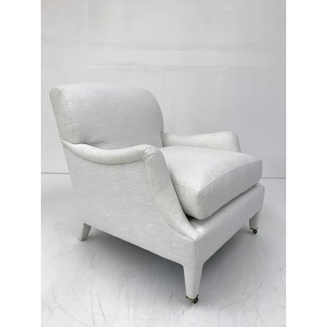 The Dorset Chair is a first quality market sample that features an Ultra Down Seat Cushion and Antique Brass Casters.