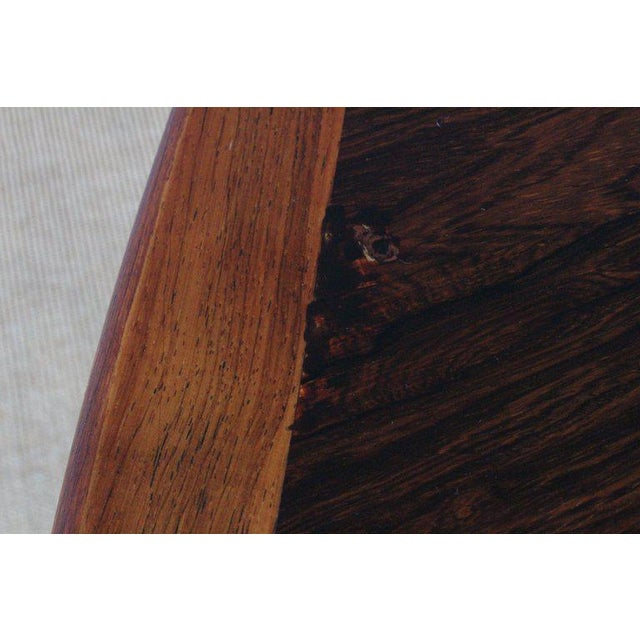 Beautiful dining table in stunning rosewood, designed by Niels Koefoed in Denmark in the 1960s. This tables features two...
