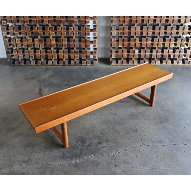 """Teak """"Krobo"""" bench by Torbjørn Afdal for Bruksbo with original labels, circa 1960. This piece has been professionally..."""