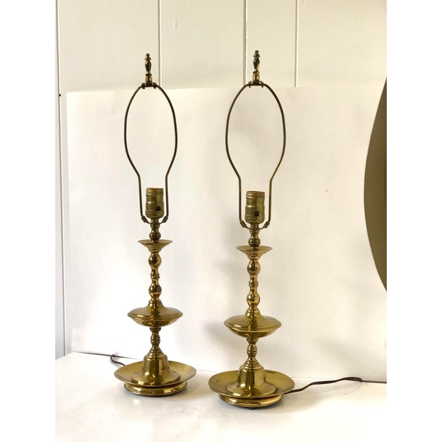 """Great pair of vintage 20th Century classic brass candlestick lamps made in the Georgian style. The lamps measure 24"""" tall..."""