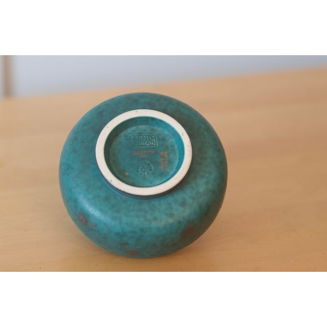 Mid Century Swedish Gustavsberg Argenta art pottery with beautiful silver overlay in the classic green color. From the...