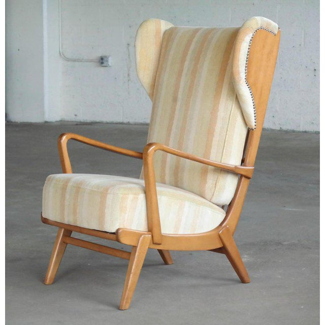 Ultra cool Scandinavian highback wing chair with exposed sides made from elm wood by an unknown maker around the 1950's....