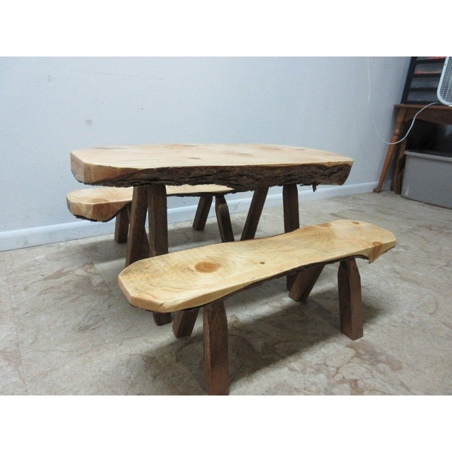 Great shape. tight and sturdy.. minor wear and a few scratches.. some bark on the underside of table and benches is a...