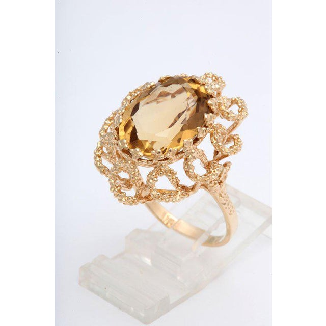 This ring has a floral feel to it Size 10 - It can be sized. H 1 in. x W .75 in. depth dimensions listed are an estimate...