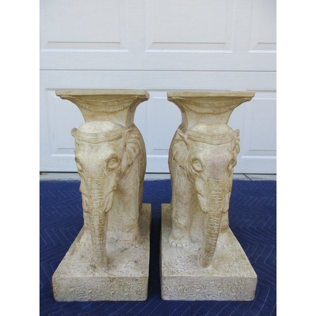 Here's a pair of two plaster elephants. Use them as pedestals to support a glass top, or as side tables. The pair is in...