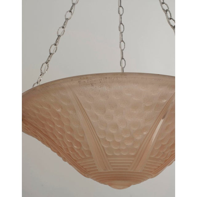 """French Art Deco (circa 1925) round pendant form pink tinted glass chandelier with a fluted round bottom and """"dot"""" design..."""