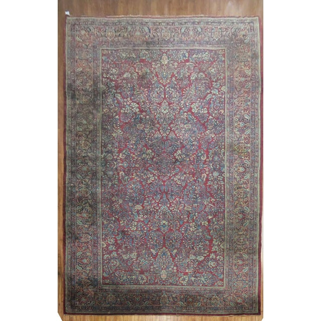 Classic Persian Sarouk Rug in classic reds and blues. Very hard size to find. Full Pile, excellent condition