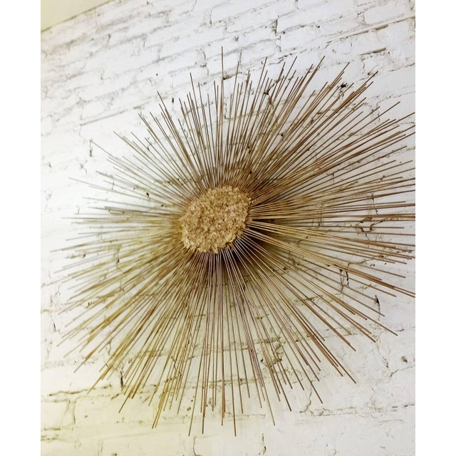 A Brutalist double layered metal Curtis Jere style Starburst wall sculpture by William & Bruce Friedle.