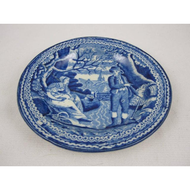 A blue and white Staffordshire transfer printed pearlware cup plate with an old stapled repair. There are collectors who...