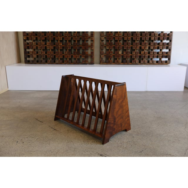Handcrafted Shedua wood magazine rack by John Nyquist. This piece is sold with the original handwritten paperwork from...