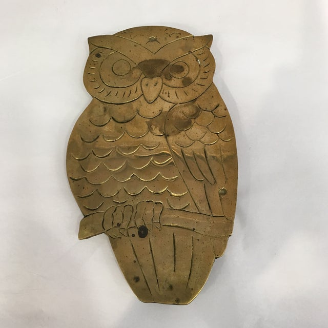 Unusual brass owl trivet which be used as decorative on a stack of books or hung on a wall