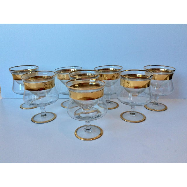 We have a gorgeous set of 8 Mid-Century Dorothy Thorpe shrimp/caviar Icers rimmed in gold. These are from an exclusive...